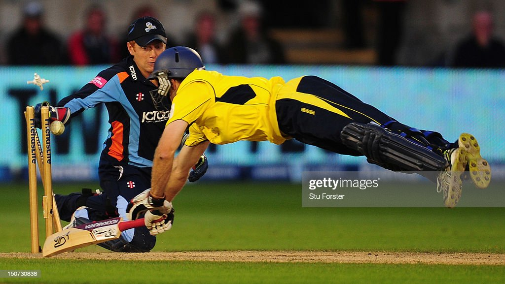 Hampshire batsman <a gi-track='captionPersonalityLinkClicked' href=/galleries/search?phrase=Simon+Katich&family=editorial&specificpeople=176577 ng-click='$event.stopPropagation()'>Simon Katich</a> is run out by Yorkshire keeper Jonny Bairstow during the final of the Friends Life T20 between Hampshire and Yorkshire at SWALEC Stadium on August 25, 2012 in Cardiff, Wales.