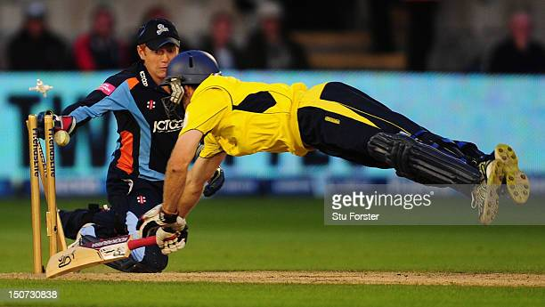 Hampshire batsman Simon Katich is run out by Yorkshire keeper Jonny Bairstow during the final of the Friends Life T20 between Hampshire and Yorkshire...