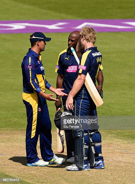Hampshire batsmen Michael Carberry and Jimmy Adams chat to Glamorgan captain Jacques Rudolph after both Hampshire openers were hit by deliveries and...