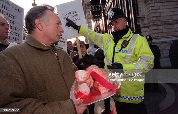 Hampshire beef farmer David Ashcroft with other farmers deliver an ox heart to Downing Street in protest at the Government's handling of the beef...
