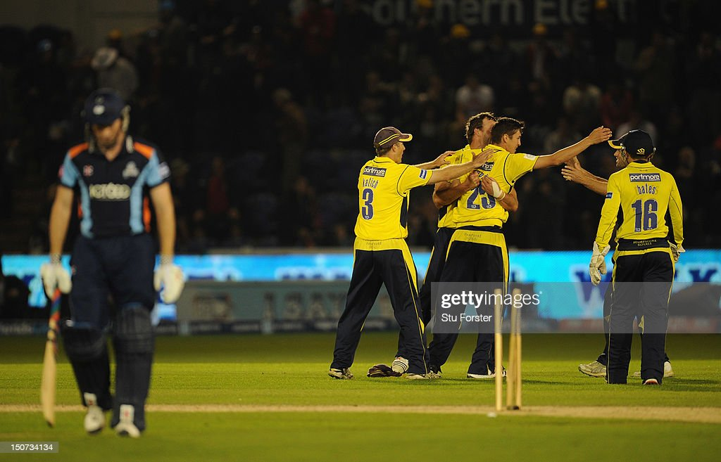 Hampshire bowler <a gi-track='captionPersonalityLinkClicked' href=/galleries/search?phrase=Chris+Wood+-+Cricket+Player&family=editorial&specificpeople=15004928 ng-click='$event.stopPropagation()'>Chris Wood</a> (c) celebrates with team mates after taking thge wicket oif Richard Pyrah in the last over during the final of the Friends Life T20 between Hampshire and Yorkshire at SWALEC Stadium on August 25, 2012 in Cardiff, Wales.