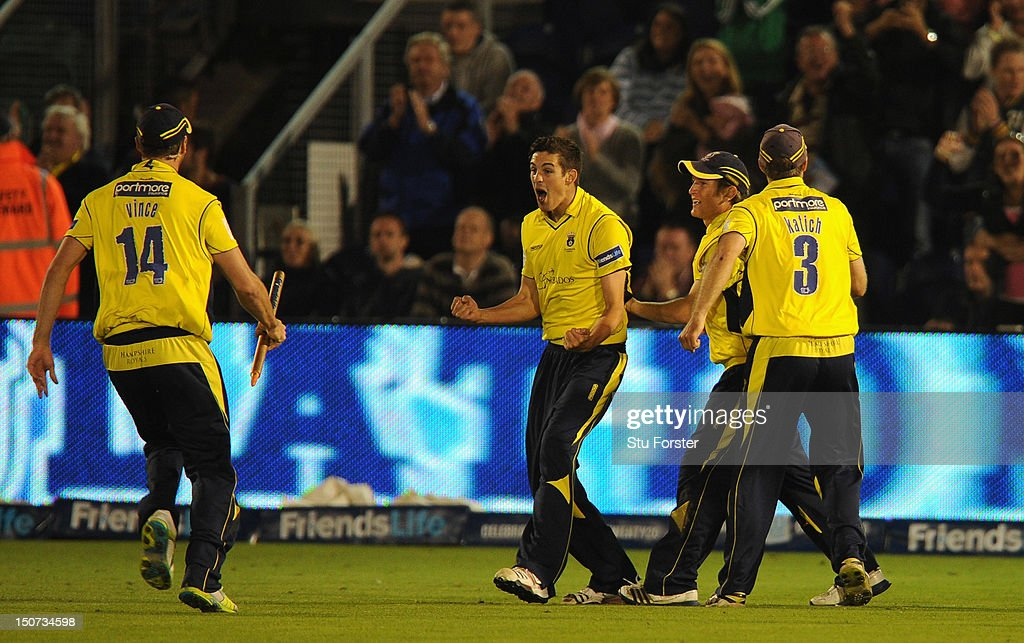 Hampshire bowler <a gi-track='captionPersonalityLinkClicked' href=/galleries/search?phrase=Chris+Wood+-+Cricket+Player&family=editorial&specificpeople=15004928 ng-click='$event.stopPropagation()'>Chris Wood</a> (c) celebrates with team mates after taking the wicket oif Richard Pyrah in the last over during the final of the Friends Life T20 between Hampshire and Yorkshire at SWALEC Stadium on August 25, 2012 in Cardiff, Wales.