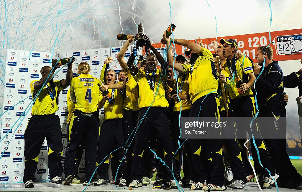 Hampshire captain Dimitri Mascarenhas lifts the trophy and celebrates with his team mates after the final of the Friends Life T20 between Hampshire and Yorkshire at SWALEC Stadium on August 25, 2012 in Cardiff, Wales.