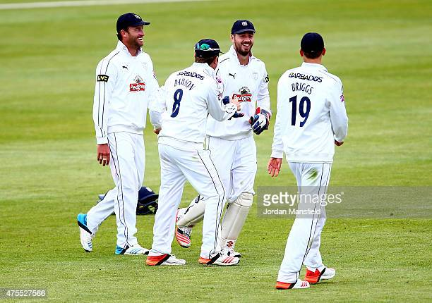 Hampshire celebrate with James Vince after he catches out Alex Gidman of Worcestershire during Day 2 of the LV County Championship Division One match...
