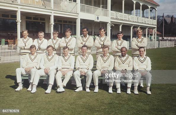 Hampshire County Cricket Club team members posed together in front of the County Ground pavilion and clubhouse in Southampton England in 1969 The...