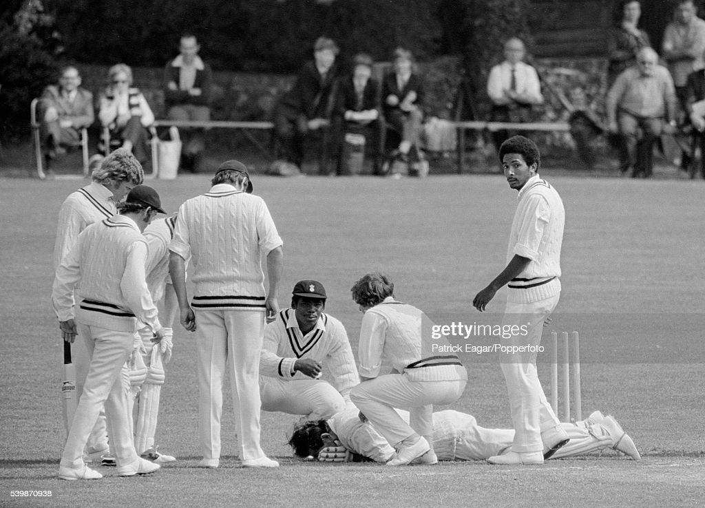 Hampshire players attend to Colin Cowdrey of Kent after he was struck by a bouncer from Andy Roberts of Hampshire and fell onto his wicket during the...
