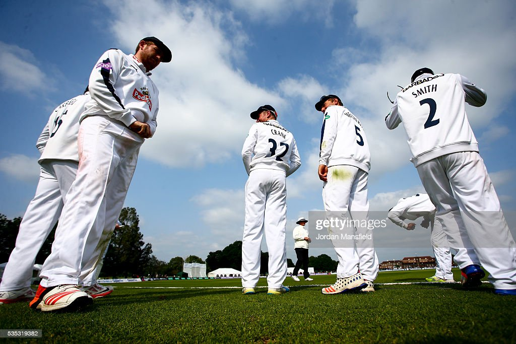 Hampshire players wait at the boundary to make their way back onto the field after tea during day one of the Specsavers County Championship Division One match between Middlesex and Hampshire at Merchant Taylors' School on May 29, 2016 in Northwood, England.