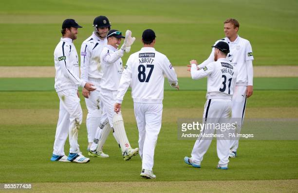 Hampshires' Adam Wheater is congratulated by his team mates after running out Derbyshire's Tim Groenewald during the LV County Championship match at...