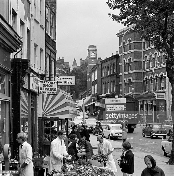 Hampstead High Street Hampstead London 19671975 Shoppers outside a greengrocers shop at number 76 with the Bird in Hand public house and Hampstead...