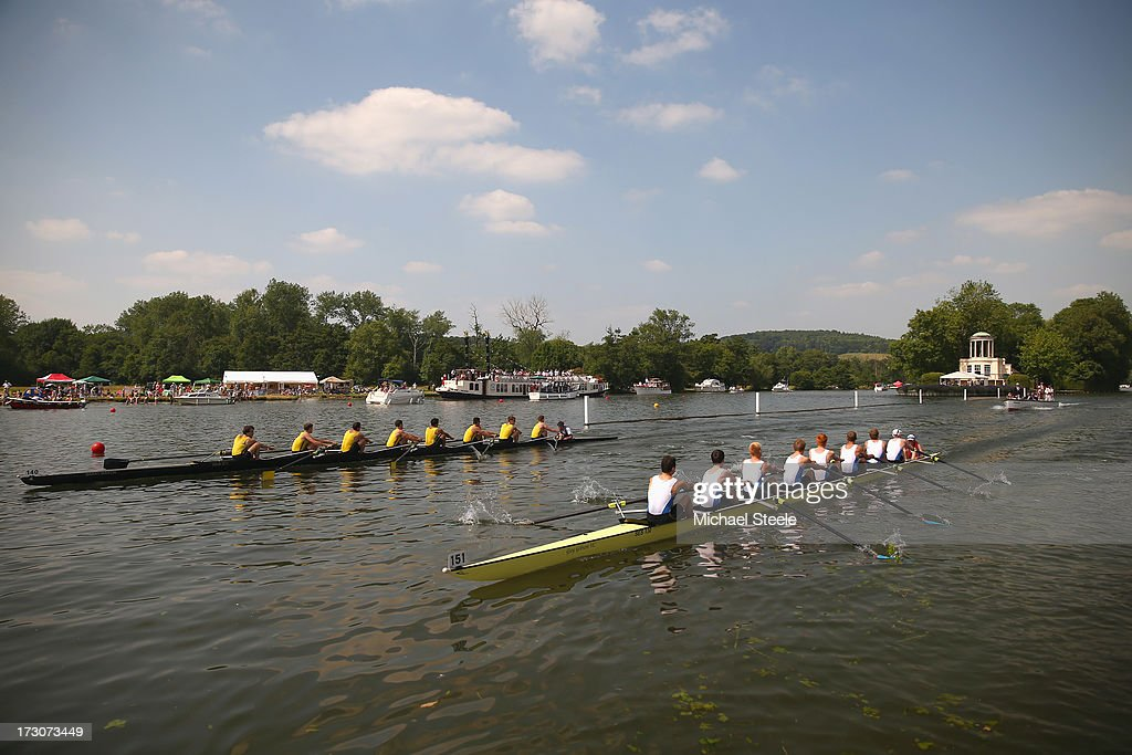 Hampton School (L) racing St.Edward's School (R) in the Princess Elizabeth Challenge Cup race pass Temple Island during day four of the Henley Royal regatta on July 6, 2013 in Henley-on-Thames, England.