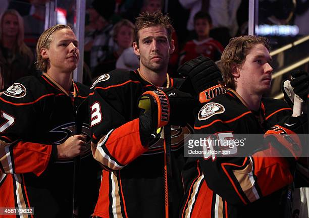 Hampus Lindholm Clayton Stoner and Sami Vatanen of the Anaheim Ducks stand during the national anthem before the game against the Minnesota Wild on...
