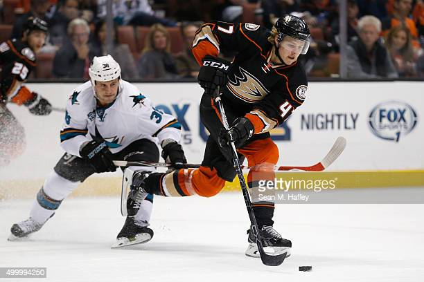 Hampus Lindholm of the Anaheim Ducks avoids Micheal Haley of the San Jose Sharks at Honda Center on December 4 2015 in Anaheim California