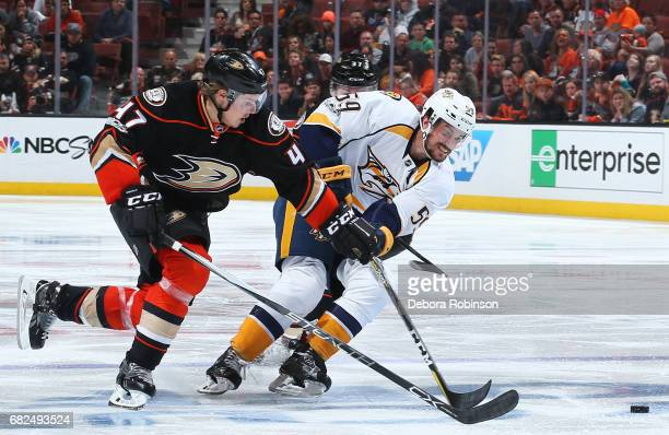Hampus Lindholm of the Anaheim Ducks battles for the puck against Roman Josi of the Nashville Predators in Game One of the Western Conference Final...