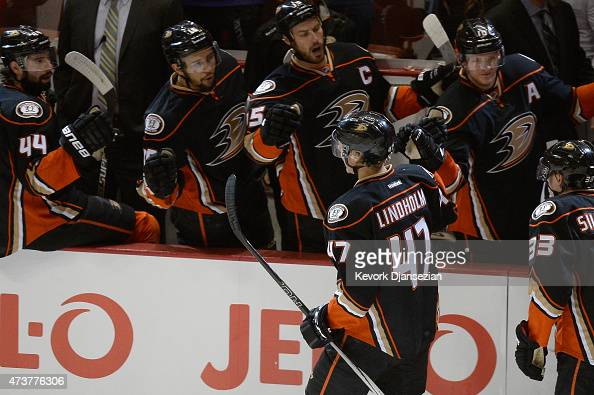 Hampus Lindholm of the Anaheim Ducks celebrates his first period goal with teammates Ryan Getzlaf Corey Perry Emerson Etem and Nate Thompson in Game...
