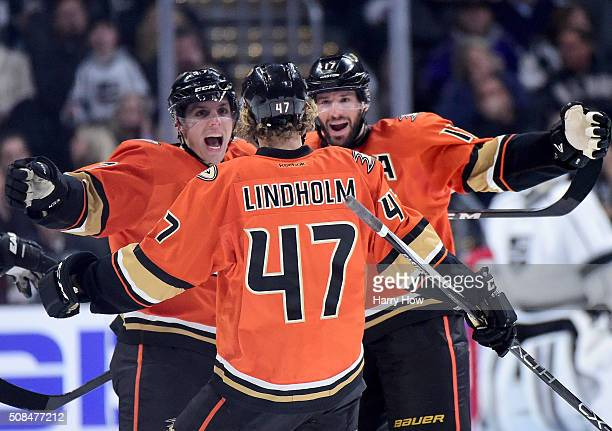 Hampus Lindholm of the Anaheim Ducks celebrates his goal with David Perron and Ryan Kesler to take a 41 lead over the Los Angeles Kings during the...