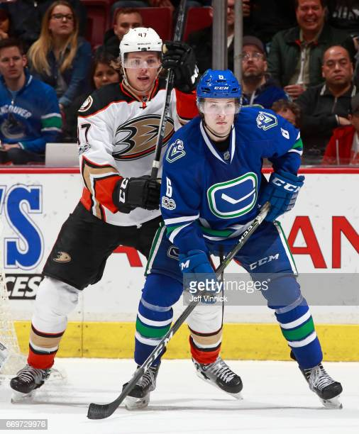 Hampus Lindholm of the Anaheim Ducks checks Brock Boeser of the Vancouver Canucks during their NHL game at Rogers Arena March 28 2017 in Vancouver...