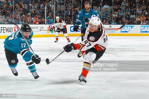 Hampus Lindholm of the Anaheim Ducks shoots the puck against John McCarthy of the San Jose Sharks at SAP Center on September 26 2015 in San Jose...