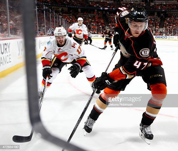 Hampus Lindholm of the Anaheim Ducks skates against Lance Bouma of the Calgary Flames in Game Five of the Western Conference Semifinals during the...