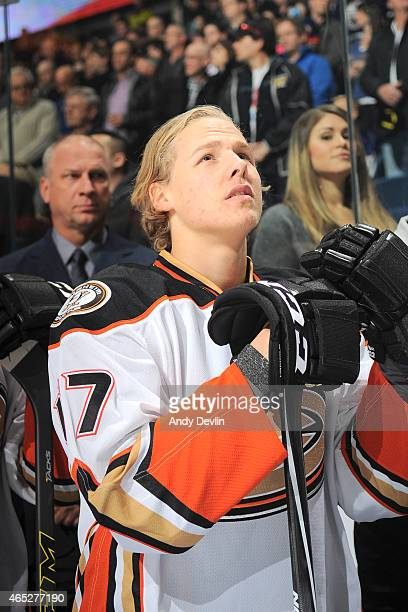 Hampus Lindholm of the Anaheim Ducks stands for the singing of the national anthem prior to the game against the Edmonton Oilers on February 21 2015...