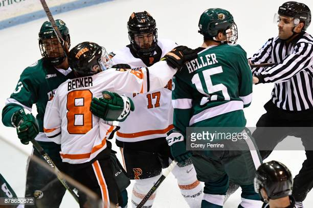 Hampus Sjödahl of the Bemidji State Beavers holds off Max Becker of the Princeton Tigers as he lunges at Jordan Heller of the Bemidji State Beavers...