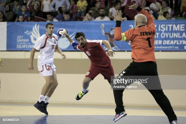 Hamza Alkoyun of Turkey in action against Vladimir Tepevac and Uros Stojkovic of Serbia during a handball match between Serbia and Turkey within 23rd...