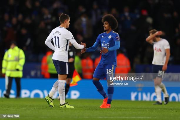 Hamza Choudhury of Leicester City shakes hands with Erik Lamela of Tottenham Hotspur after the Premier League match between Leicester City and...