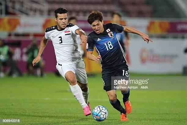 Hamzah Adnan Lafloof of Iraq and Takumi Minamino of Japan during the AFC U23 Championship semi final match between Japan and Iraq at the Abdullah Bin...