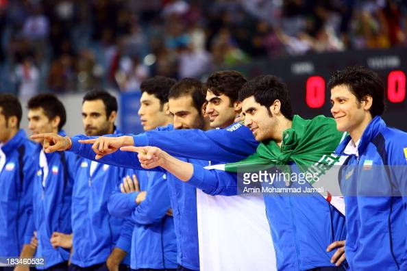 Hamzeh Zarini and Amir Ghafour and Shahram Mahmoudi poses for Photographer during 17th Asian Men's Volleyball Championship between Iran And Korea on...