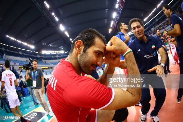 Hamzeh Zarini celebrates after wining during 17th Asian Men's Volleyball Championship between Iran And Korea on October 6 2013 in Dubai United Arab...