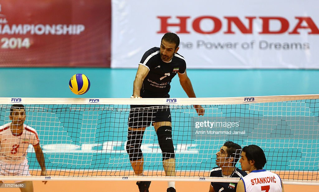 Hamzeh Zarini of Iran (C) in action during the Volleyball World League between Iran and Serbia on June 23, 2013 in Tehran, Iran Azadi Complex.