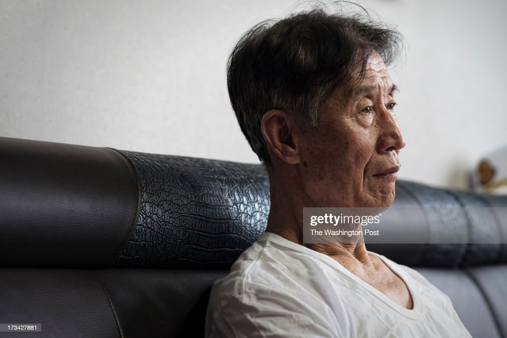 Han Byung-soo, 82, watches news on TV at a care house on July 10, 2013 in Seoul, South Korea. Han escaped from a coal mine in North Korea in 2004.