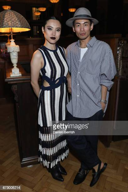 Han Chong and guest attend Roland Mouret's The Dinner of Love at Cecconi's a preopening dinner at The Ned on April 25 2017 in London England