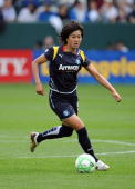 Han Duan he Los Angeles Sol dribbles the ball on the attack against the Washington Freedom during their inaugural WPS match in the first half at The...
