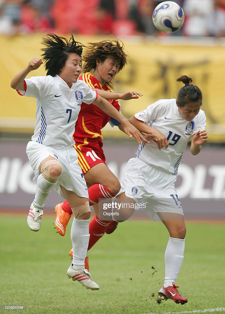 Han Duan of China vies with Kim Kyul Sil and Hwang Bo Ram during the friendship match between China national women's soccer team and Korea in...