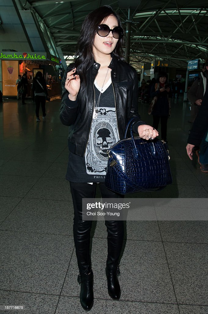 <a gi-track='captionPersonalityLinkClicked' href=/galleries/search?phrase=Han+Ga-In&family=editorial&specificpeople=7406282 ng-click='$event.stopPropagation()'>Han Ga-In</a> is seen at Incheon International Airport on December 6, 2012 in Incheon, South Korea.