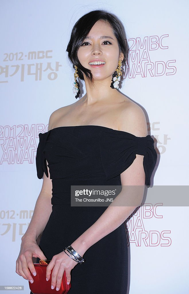 Han GaIn poses for photographs upon arrival during the 2012 MBC Drama Awards at MBC Open Hall on December 30 2012 in Seoul South Korea