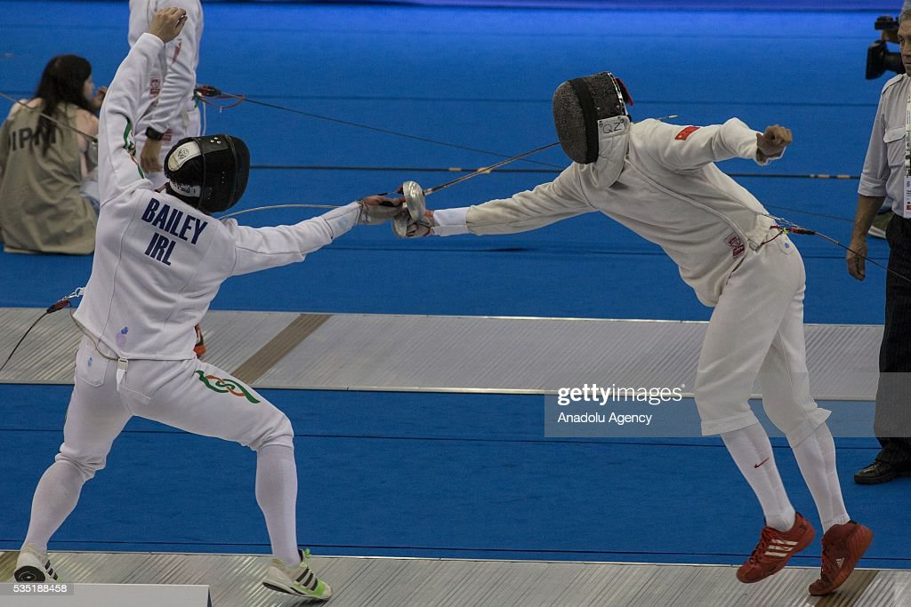 Han Jiahao (R) from China and Bailey Eanna from Italy compete in the fencing at the mixed relay World Championship in modern pentathlon in Olympic Sports Complex in Moscow, Russia, on May 29, 2016.