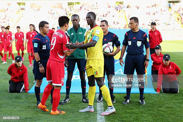 Han Kwang Song of Korea DPR and Abdoul Dante of Mali participate in the handshake for peace during the FIFA U17 World Cup Chile 2015 Round of 16...