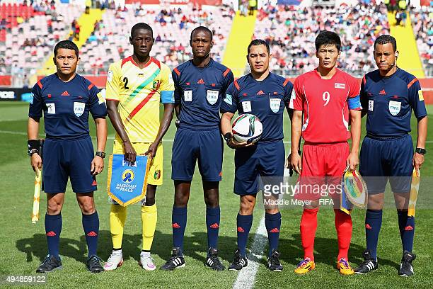 Han Kwang Song of Korea DPR and Abdoul Dante of Mali stand with referees before the FIFA U17 World Cup Chile 2015 Round of 16 match between Mali and...