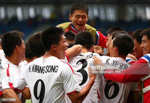 Han Kwang Song of Korea DPR and his teammates surround teammate Pak Yong Gwan near the bench area after Pak's goal during the Costa Rica v Korea DPR...