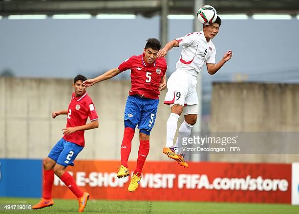 Han Kwang Song of Korea DPR heads a ball to the middle over Esteban Gonzalez of Costa Rica during the Costa Rica v Korea DPR Group E FIFA U17 World...