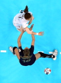Han Na Gwon of South Korea scores over Begona Fernandez Molinos of Spain during the Women's Handball Bronze Medal Match on Day 15 of the London 2012...