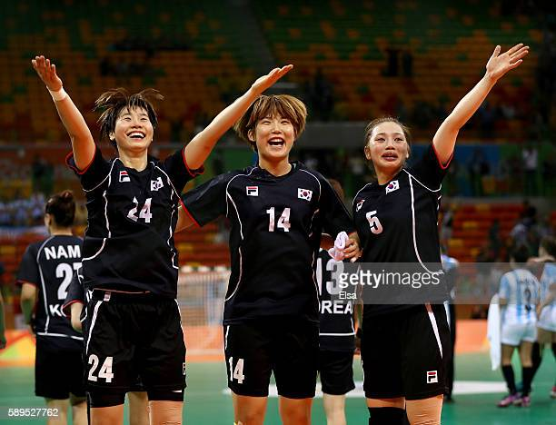 Han Na GwonJinyi Kim and Yura Jung of Korea celebrate the win over Argentina on Day 9 of the Rio 2016 Olympic Games at the Future Arena on August 14...