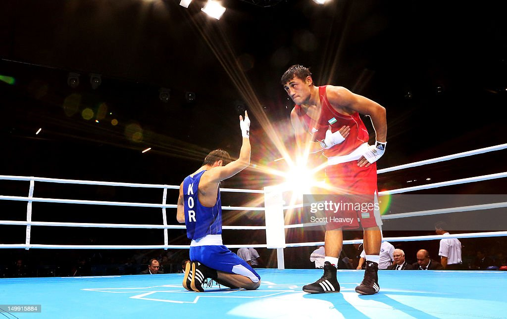 Han Soonchul of Korea (L) celebrates his victory over Fazliddin Gaibnazarov of Uzbekistan during the Men's Light (60kg) Boxing on Day 10 of the London 2012 Olympic Games at ExCeL on August 6, 2012 in London, England.