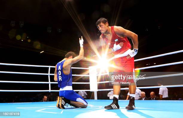 Han Soonchul of Korea celebrates his victory over Fazliddin Gaibnazarov of Uzbekistan during the Men's Light Boxing on Day 10 of the London 2012...