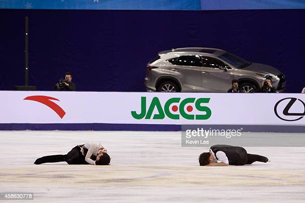 Han Yan of China and Yuzuru Hanyu of Japanlie on the course after collision at warm up period in Men Free Skating during the Lexus Cup of China 2014...