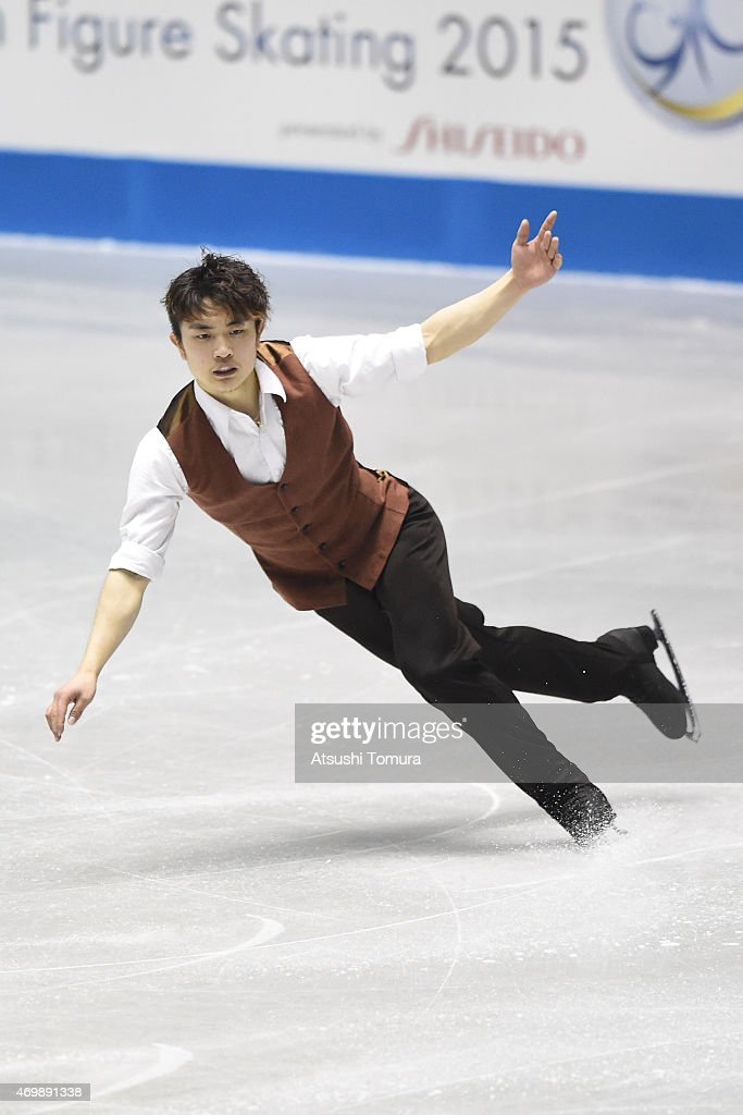 Han Yan of China competes in the men's short program during the day one of the ISU World Team Trophy at Yoyogi National Gymnasium on April 16, 2015 in Tokyo, Japan.