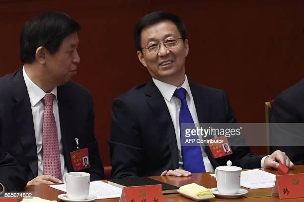 Han Zheng secretary of the Shanghai Municipal Party Committee and member of the Political Bureau talks to Li Zhanshu secretary of the Central...