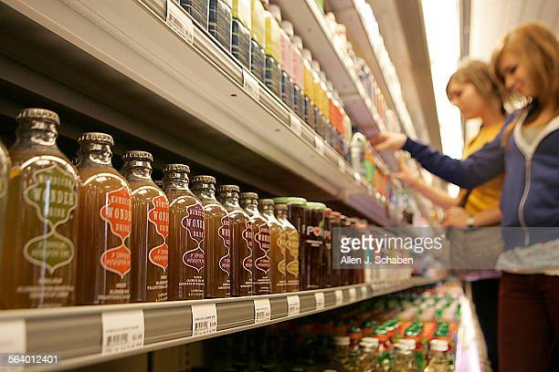 Hana Lurie left and Alison Sieke both of Culver City look over drinks including a variety of Kombucha drinks at Famima a Japanese convenience store...