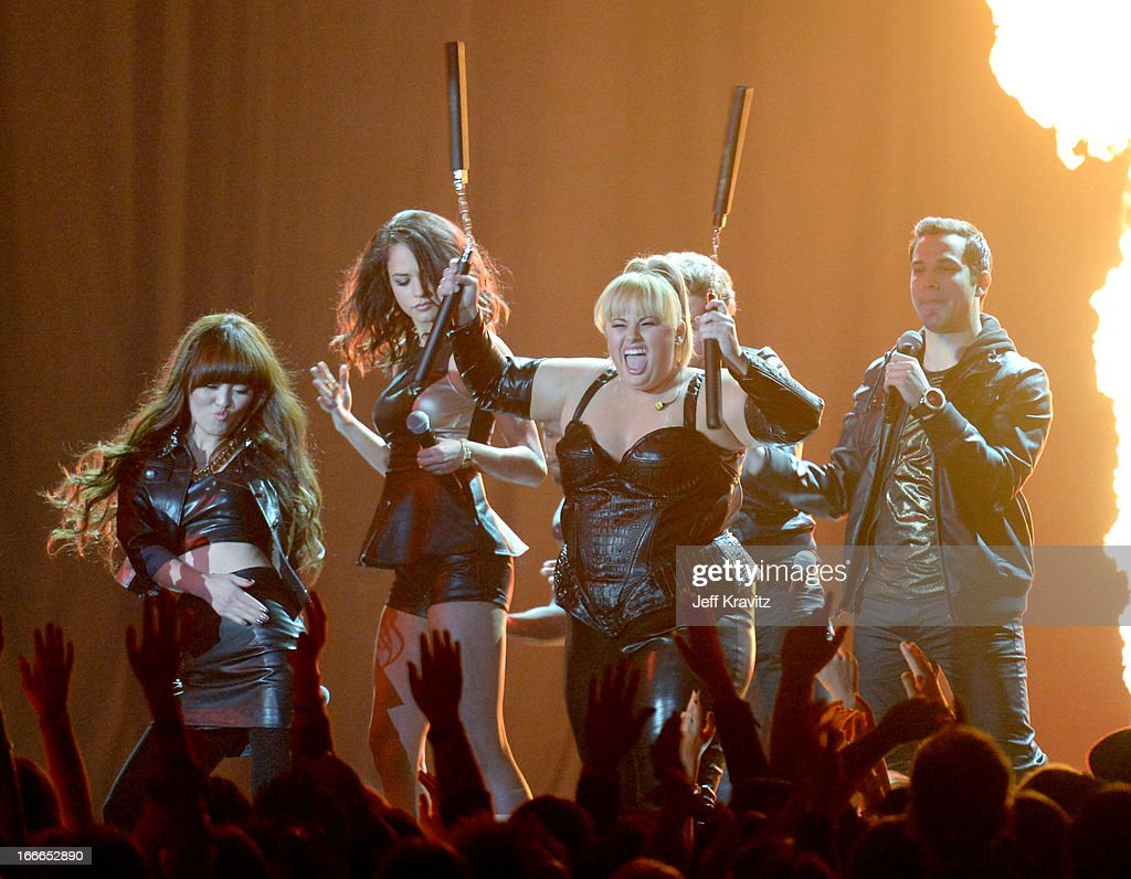 Hana Mae Lee, Alexis Knapp, Rebel Wilson, and Skylar Astin perform onstage during the 2013 MTV Movie Awards at Sony Pictures Studios on April 14, 2013 in Culver City, California.